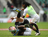 LONDON, ENGLAND - Sunday 11 May 2014, Ben Lam of New Zealand is caught by Branco du Preez of South Africa during the Cup quarter final match between South Africa and New Zealand at the Marriott London Sevens rugby tournament being held at Twickenham Rugby Stadium in London as part of the HSBC Sevens World Series.<br /> Photo by Roger Sedres/ImageSA