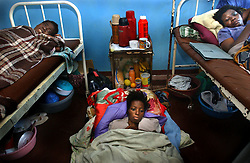 Malawian women suffering from the HIV virus lie in beds and on the floor because of lack of space at the Queen Elizabeth Hospital in Blantyre, Malawi, July 4, 2002.  In Malawi, as in several other affected countries,widespread poverty and the increasing economic and social disruption caused by a devastating HIV/AIDS crisis are additional factors disrupting agriculture and causing a growing food shortage which threatens 3.2 million people in Malawi -- 500,000 of which are already affected by the crisis.  The food crisis is part of a region-wide shortage affecting several countries in southern Africa, the result of a combination of harsh climatic conditions (droughts and flooding), poor management of food reserves and political and economic instability.