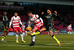 Liam Sercombe of Bristol Rovers takes on Matty Blair of Doncaster Rovers - Mandatory by-line: Robbie Stephenson/JMP - 27/01/2018 - FOOTBALL - The Keepmoat Stadium - Doncaster, England - Doncaster Rovers v Bristol Rovers - Sky Bet League One