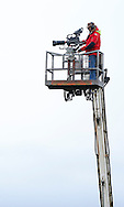 Plumpton, UK, 16th January 2017<br /> A cameraman up a crane filming for At The Races at Plumpton Racecourse.<br /> &copy; Telephoto Images / Alamy Live News