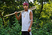 **HOLD FOR STORY BY SAMANTHA GROSS**<br /> In this photo taken July 19, 2010, John Parsons poses for a photograph holding a traditional lacrosse stick at the Onondaga Nation, N.Y, Monday, July 19, 2010. Living uneasily among Americans, many Iroquois still believe they're fighting for their own identity.<br /> (AP Photo/Heather Ainsworth)