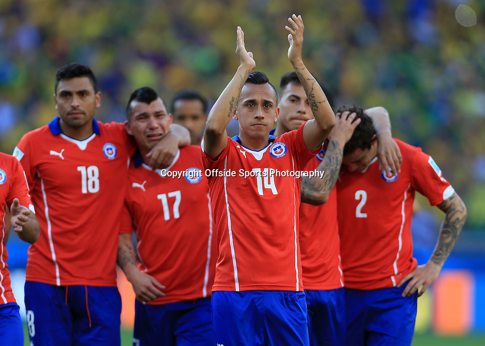 28th June 2014 - FIFA World Cup - Round of 16 - Brazil v Chile - Fabian Orellana of Chile leads the applause as the dejected players go out of the tournament - Photo: Simon Stacpoole / Offside.
