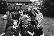 Kids with football in garden, Hawthorne Rd,High Wycombe. UK, 1990s.