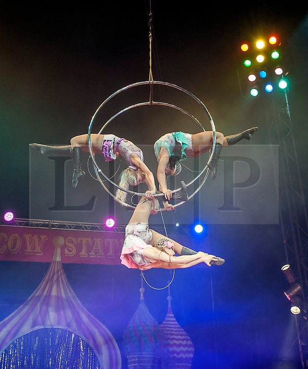 © Licensed to London News Pictures. 04/06/14 Fulham. UK. (L-R) Katia Drazdova, Olga Siamionava & Ksusha Veslovskaya rehearsing for the Moscow State Circus which is performing at The Lillie Road Recreation Ground, Fulham, London on June 04 2014. Performances run until the 8th June. Photo credit : Arnaud Stephenson/LNP