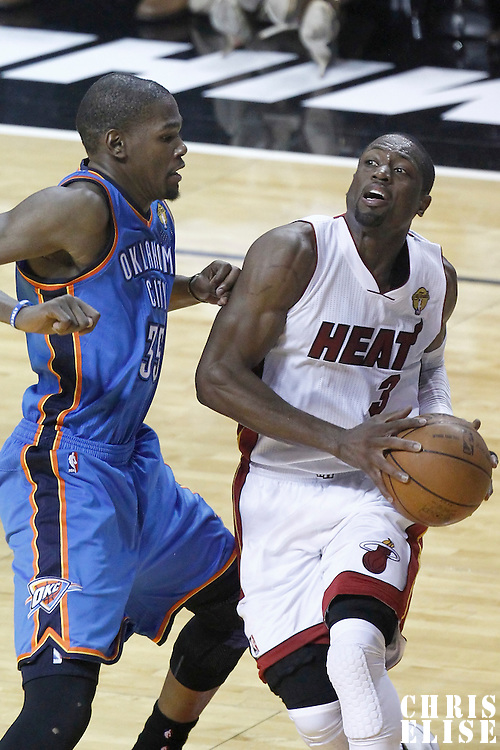17 June 2012: Miami Heat shooting guard Dwyane Wade (3) drives past Oklahoma City Thunder small forward Kevin Durant (35) during the Miami Heat 91-85 victory over the Oklahoma City Thunder, in Game 3 of the 2012 NBA Finals, at the AmericanAirlinesArena, Miami, Florida, USA.