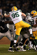 Green Bay Packers rookie defensive tackle Tyler Lancaster (95) leaps in the air as he tries to block a pass during the 2018 NFL preseason week 3 football game against the Oakland Raiders on Friday, Aug. 24, 2018 in Oakland, Calif. The Raiders won the game 13-6. (©Paul Anthony Spinelli)