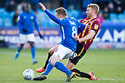 Macclesfield Town midfielder Jay Harris challenged by Bradford City midfielder Chris Taylor  during the EFL Sky Bet League 2 match between Macclesfield Town and Bradford City at Moss Rose, Macclesfield, United Kingdom on 30 November 2019.