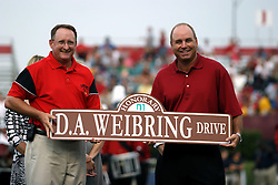 08 September 2007: In a pre-game ceremony, Town of Normal City Manager Mark Peterson presents D.A. Weibring with a street sign commemorating the naming of Gregory street to D.A. Weibring Drive.  Weibring is an ISU alum and a professional golfer. The Murray State Racers were defeated by the Illinois State Redbirds 43-17 in a nightcap at Hancock Stadium on the campus of Illinois State University in Normal Illinois.