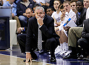 BYU head coach Dave Rose watches his team during the second half of an NCAA college basketball game against Utah State, Wednesday, Nov. 17, 2010 in Provo, Utah. BYU defeated Utah State 78-72(AP Photo/Colin E Braley)