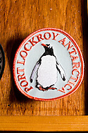 Antactica. port Lockroy british base, souvenir shop, tourists  GOUDIER island - Antarctica  <br /> /<br /> port Lockroy  base anglaise, magasin de souvenirs du bout du monde, touristes<br /> Shopping base anglaise de Port Lockroy sur l'île de Goudier<br /> Ecussons, 10 $<br /> Mini-map, 5 $<br /> Visitor's kit (posters sur la vie sauvage en Antarctique), 5 $<br /> First day cover stamp, 8-10 $<br /> Cartes postales, 1 ou 2 $<br /> Stylos, 1 $<br /> Magnets, 8 $<br /> Carvate en tartan, 25 $<br /> Carré en soie tartan, 45 $<br /> Bonnets, 20 $<br /> Tee-shirt, 30 $<br /> Polos, 50 $<br /> Peluches manchots, 15 $<br /> Stickers, 1 $<br /> Tea towel, 15 $  ile GOUDIER - Antarctique <br /> /<br /> ANTAR056