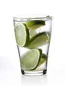 Studio shot of drink with lime slices