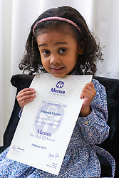 Four-year-old Alannah George who has an IQ of 140 and taught herself to read at two-and-a-half, proudly displays her Mensa certificate. Iver, Buckinghamshire, March 10 2019.