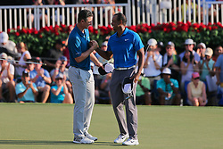 September 22, 2018 - Atlanta, Georgia, United States - Tiger Woods (R) and Justin Rose shake hands on the 18th green after the third round of the 2018 TOUR Championship. (Credit Image: © Debby Wong/ZUMA Wire)