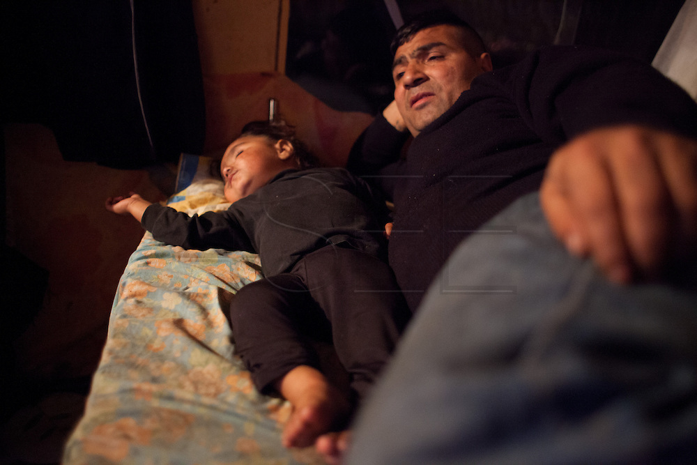 Nicolae moved with his family from Barcelona to Lille one year ago. He is living with his family in a caravan in a settlement on the outskirts of Lille. //France is the land of destination of many Roma people in their diaspora across Europe, who live camped in many settlements at the outskirts of cities. In 2013, the French Government has expelled thousands of Gypsies from the East as in 2010, 2011 and 2012, this time without any financial aids. Many Roma live afraid to be expelled but they remain in the French country with the hope of receiving some kind of aid. Outskirts of Lille, France. December 2013.