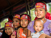25 OCTOBER 2015 - SHWEPYITHAR, MYANMAR: National League for Democracy activists in the back of a truck in Shwepyithar, Myanmar, during a political rally and motorcade in the small town about 90 minutes from Yangon. Political parties are in fill campaign mode in Myanmar (Burma). National elections are scheduled for Sunday Nov. 8. The two principal parties are the National League for Democracy (NLD), the party of democracy icon and Nobel Peace Prize winner Aung San Suu Kyi, and the ruling Union Solidarity and Development Party (USDP), led by incumbent President Thein Sein. There are more than 30 parties campaigning for national and local offices.     PHOTO BY JACK KURTZ