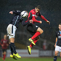 Dundee v St Johnstone....08.11.14   SPFL<br /> Brian Graham gets above James McPake<br /> Picture by Graeme Hart.<br /> Copyright Perthshire Picture Agency<br /> Tel: 01738 623350  Mobile: 07990 594431