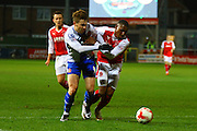 Walsall FC forward Tom Bradshaw and Fleetwood Town Defender Amari'i Bell battle during the Sky Bet League 1 match between Fleetwood Town and Walsall at the Highbury Stadium, Fleetwood, England on 15 March 2016. Photo by Pete Burns.