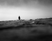 "Margate's ""another time"" Antony Gormley sculpture as teh tide rushes in across the beach. Pentax 67"