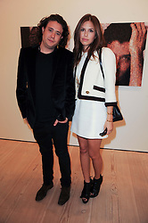 DASHA ZHUKOVA and ADAM WAYMOUTH at the BRIC art sale preview (Brazil, Russia, India & China, the acronym BRIC here refers to the burgeoning contemporary art practices within these four countries.) organised by Phillips de Pury & Company at The Saatchi Gallery, London on 17th April 2010.