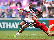 USA player toys to break a tackle during the game USA vs Wales during the Cathay Pacific/HSBC Hong Kong Sevens festival at the Hong Kong Stadium, So Kon Po, Hong Kong. on 7/04/2018. Picture by Ian  Muir.