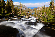 Upper Velma Lake and Lake Tahoe as seen from the stream flowing out of Fontanelles lake in Desolation Wilderness.
