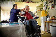 In Home Supportive Services (IHSS) caregiver Teresita Perez de Godoy, left, feeds quadriplegic Francisco Godoy in his Sacramento, CA home January 22, 2010. Francisco needs around-the-clock care from Teresita, his ex-wife who also lives with him. The state pays Teresita for 283 hours per month, at $10.40/hour. Gov. Schwarzenegger has proposed cutting or eliminating the IHSS program which provides care for 450,000 Californians and jobs for 375,000 caregivers. If the program was eliminated, most would need to be institutionalized, likely at far greater taxpayer expense. CREDIT: Max Whittaker for The Wall Street Journal.CABUDGET