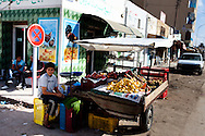 A boy sells fruit in Sidi Bouzid, the town where a fruit seller Mohamed Bouazizi lit himself on fire to protest against the town's authorities. This act sparked the Arab spring, but little has changed in Sidi Bouzid.