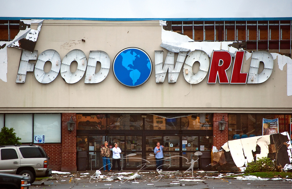 People stand outside Food World on Theodore Dawes Road following a tornado March 9, 2011 in Theodore, Ala. The grocery store was among several structures heavily damaged when an EF-2 tornado moved through the area around 9 a.m. Wednesday morning. Three people were injured, and 17,000 residents were left without power following the storm. (Photo by Carmen K. Sisson/Cloudybright)