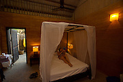 Phu Quoc Island. Ong Lang Beach. Mango Bay Resort. Mosquito net in a rammed earth bungalow.