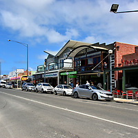 Storefronts in Apollo Bay on Great Ocean Road, Australia<br /> Apollo Bay is at the halfway point of your scenic drive. When it was founded in 1853 by European settlers – predominantly timber cutters – it was called Middleton. This town of 1,600 residents offers several attractions. The most popular are camping and hiking through the rainforest of The Otways. You will be thrilled by the wildlife, flora and abundant waterfalls. The Apollo Bay Information Centre on Collingwood Street (local name for the Great Ocean Drive) will be happy to help plan your adventure.