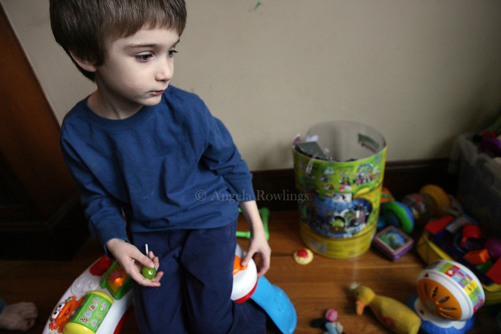 (013008  Boston, MA) Aidan Sumner, 4, sits in his livingroom with his toys, Wednesday,  January 30, 2008.  Aidan, who has lead poisoning, and his family being evicted from their Roslindale home where he contracted the lead poisoning.  Staff photo by Angela Rowlings.