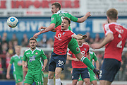 Jordan White (Wrexham AFC) out jumps Danny Parslow (York City) to win the header during the Vanarama National League match between York City and Wrexham FC at Bootham Crescent, York, England on 17 April 2017. Photo by Mark P Doherty.