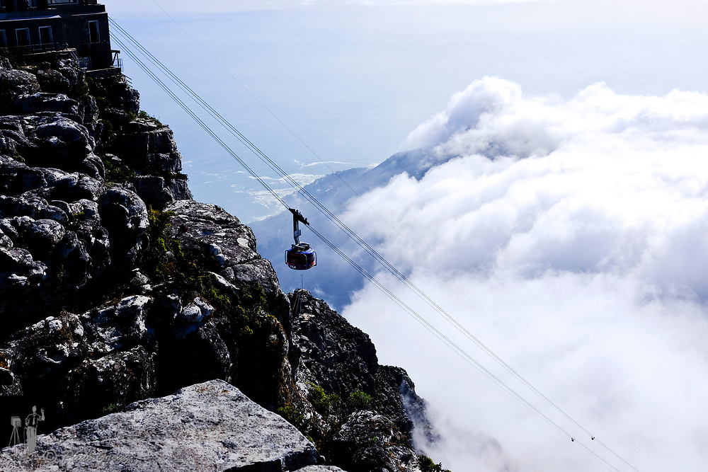 Cape Town, South Africa. The cable car descends into the cloud layer from the top cable car station.