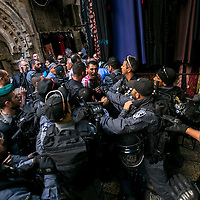 Israeli anti riot police officers prevent a  Palestinian man under the age of 40 years old to enter the Al Aqtsa compound before the Friday pray. <br />