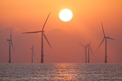 © Licensed to London News Pictures. 01/09/2017. Skegness, UK.  Sunrise over the Lincs Offshore Wind Farm off the coast of Lincolnshire this morning, the start of the meteorological autumn, 1st September 2017. Photo credit: Rob Arnold/LNP