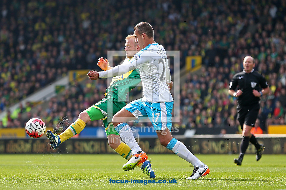 Steven Naismith of Norwich and Steven Taylor of Newcastle United in action during the Barclays Premier League match at Carrow Road, Norwich<br /> Picture by Paul Chesterton/Focus Images Ltd +44 7904 640267<br /> 02/04/2016