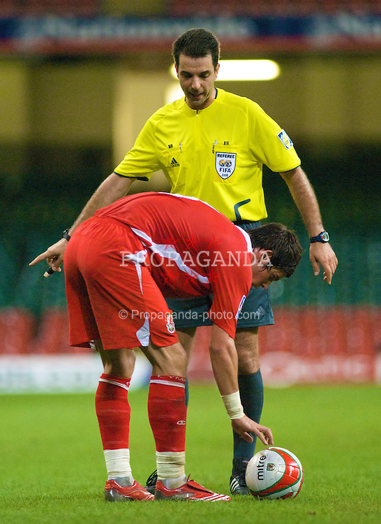 CARDIFF, WALES - Friday, September 5, 2008: Wales' Gareth Bale is booked by referee Aleksandr Stavrev for taking a free-kick too quickly against Azerbaijan during the opening 2010 FIFA World Cup South Africa Qualifying Group 4 match at the Millennium Stadium. (Photo by Gareth Davies/Propaganda)