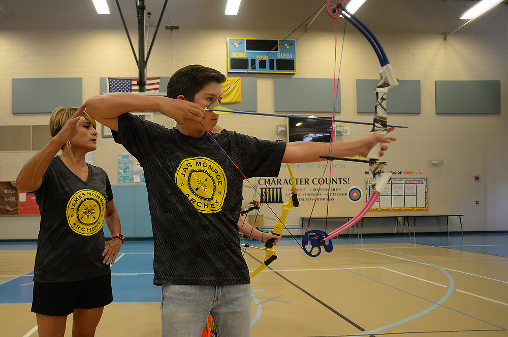 apl050817c/SPORTS/pierre-louis/JOURNAL 050817<br /> James Monroe Middle School Archery coach B.J. Pacheco,, left , works with Aiden Krafft,,13,  during  practice . The team recently won a state championship and  will compete in Kentucky May 11 -14  .Photographed on Monday May 8 2017. .Adolphe Pierre-Louis/JOURNAL