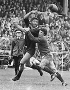 Frank Shelford gets his pass away despite the intentions of Divan Serfontein. Third test v Boks, 1981. New Zealand All Blacks v South Africa. Photo: PHOTOSPORT/Peter Bush