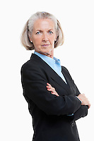 Portrait of senior woman businesswoman with arms crossed against white background