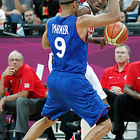 29 July 2012: USA Kobe Bryant looks to pass the ball past Tony Parker of France during a 98-71 Team USA victory over Team France, during the men's basketball preliminary, at the Basketball Arena, in London, Great Britain.