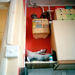 The gas meter in one of the flats on the Aylesbury Estate in London where a family live below the poverty line. The family must pay for their gas and electricty before they can use it. When the money runs out it simple cuts of the gas and electrcity.