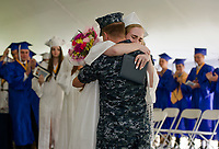 Lindsey Rosette is surprised by her brother Matthew Rosette moments after receiving her diploma during Inter-Lakes High School graduation Saturday morning at Prescott Park.  (Karen Bobotas/for the Laconia Daily Sun)