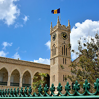 Flag above Clock Tower at Parliament Buildings in Bridgetown, Barbados <br />