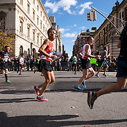 NYTRUN - NOV. 6, 2016 - NEW YORK - Runners in the 2016 TCS New York City Marathon head down 5th Ave. near E 91st Street on Sunday afternoon. NYTCREDIT:  Karsten Moran for The New York Times