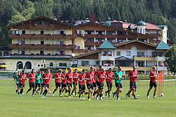 14.07.2013, Walchsee, AUT, FC Augsburg, Trainingslager, im Bild Warmlaufen auf dem Trainingsplatz vor dem Mannschaftshotel Seehof (vorne) und See Residenz (hinten) // during a trainings session of German 1st Bundesliga club FC Augsburg at their training camp in Walchsee, Austria on 2013/07/14. EXPA Pictures &copy; 2013, PhotoCredit: EXPA/ Eibner/ Klaus Rainer Krieger<br /> <br /> ***** ATTENTION - OUT OF GER *****