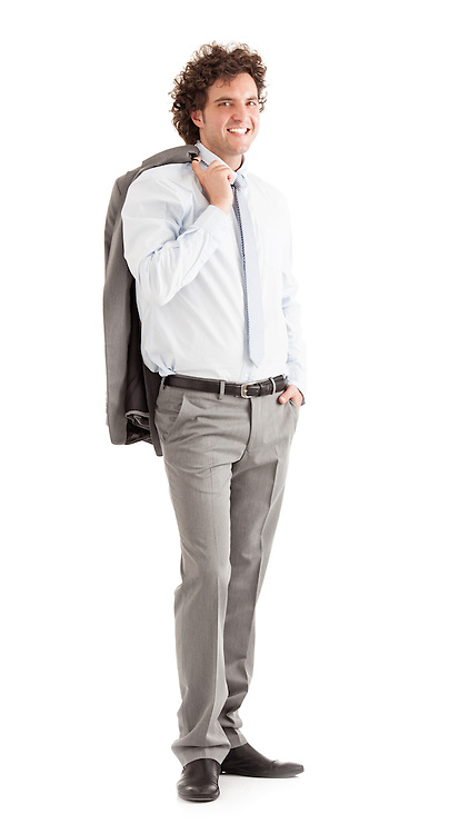 Smiling young businessman carrying his jacket over his shoulder.