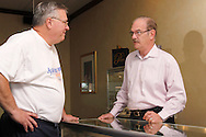 Dave Hungler of Centerville (left) talks with Jim Pridgen at Pridgen Jewelers in Centerville, Ohio, Saturday, August 25, 2012.