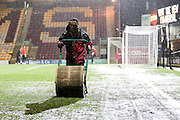 Groundsman clearing up the rain water during the Sky Bet League 1 match between Bradford City and Barnsley at the Coral Windows Stadium, Bradford, England on 26 January 2016. Photo by Simon Davies.