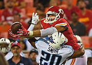 Tight end Gavin Escobar #89 of the Kansas City Chiefs reaches out to catch a pass over defensive back D'Joun Smith #20 of the Tennessee Titans during the second half  at Arrowhead Stadium in Kansas City, Missouri.
